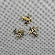 Kétfedeles repülő medál kulcstartó bronz színben