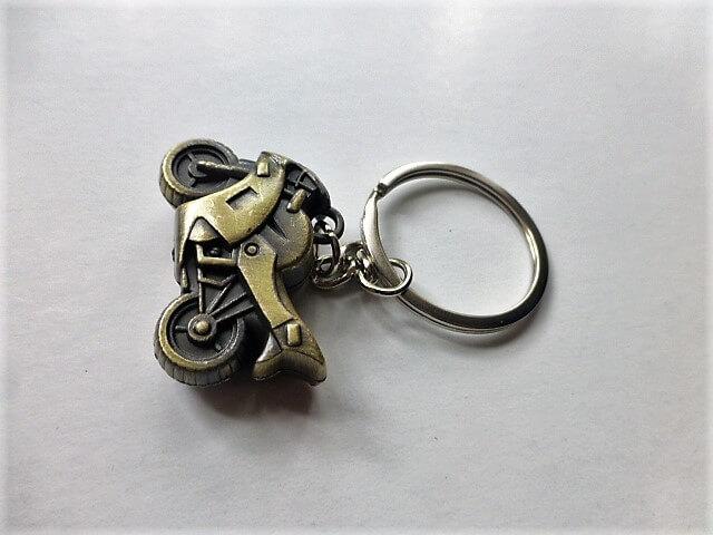 Motor kulcstartó réz színben